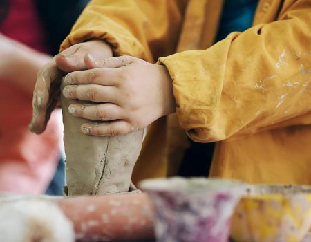 boy teen potter clay bowl working in pottery workshop traditional arts