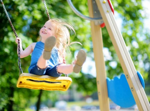 Cute,Little,Girl,Having,Fun,On,A,Playground,Outdoors,In